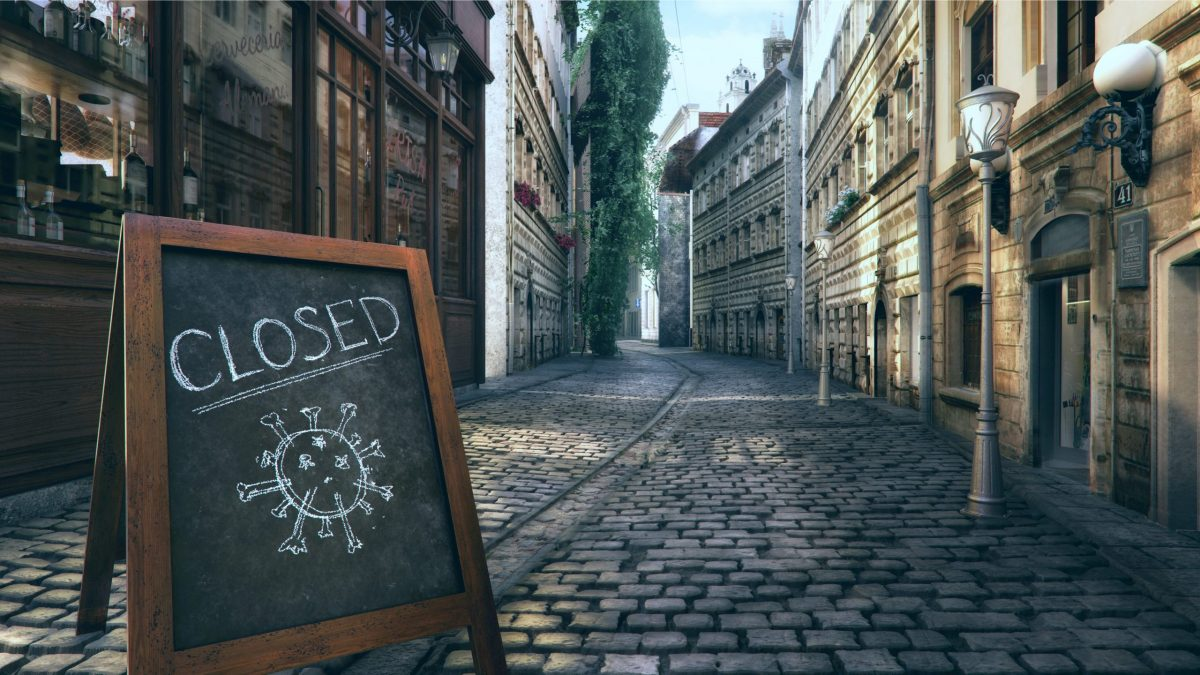 empty streets and shops, shop sign with closed written on it and a drawing of the covid virus | Rogson Law Firm
